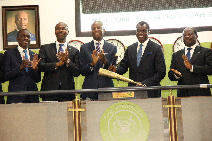L – R: Mr. Kunle Ayodeji, Executive Director, Finance & Operations, Computer Warehouse Group (CWG Plc); Mr. Phillip Obioha, Chief Operating Officer, CWG Plc; Mr. Ade Bajomo, Executive Director, Market Operations and Technology, NSE; Mr. Austin Okere, Chief Executive Officer, CWG Plc; and Mr. James Agada, Chief Technology Officer, CWG Plc at the Closing Gong Ceremony at the Nigerian Stock Exchange (NSE).