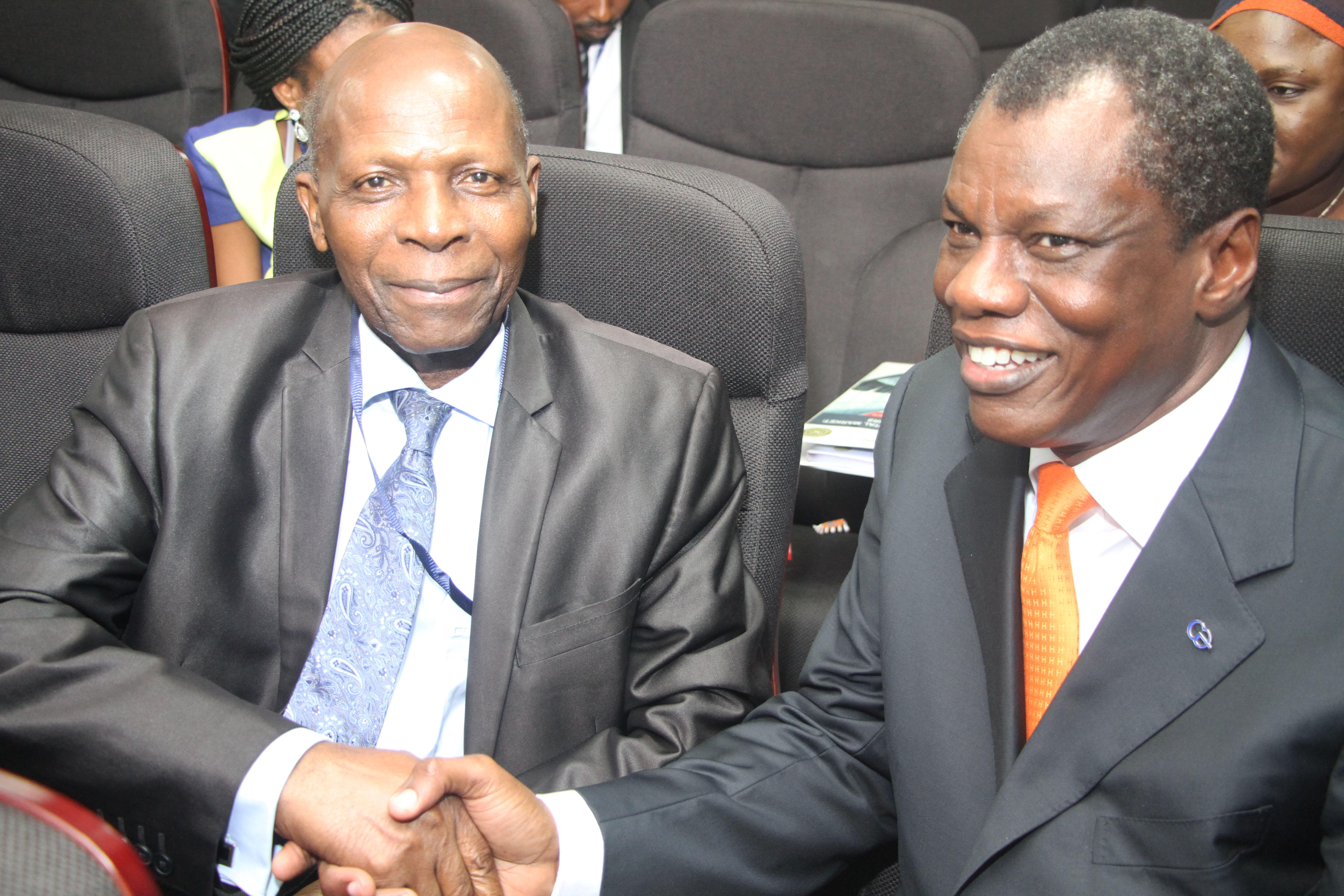 Austin with past deputy governor of the Central bank of Nigeria, Mr , Victor Odozi..